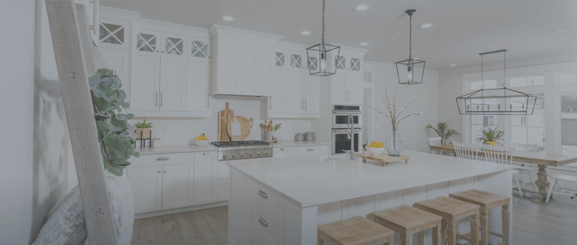 Interior photo of white kitchen with island