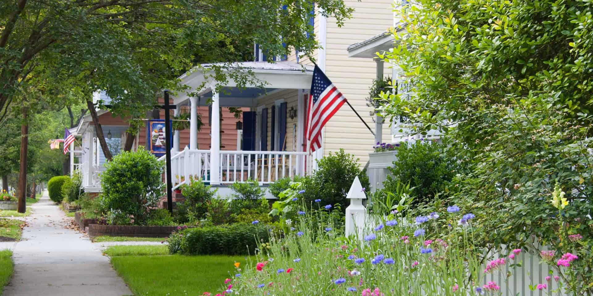 neighborhood sidewalk with houses