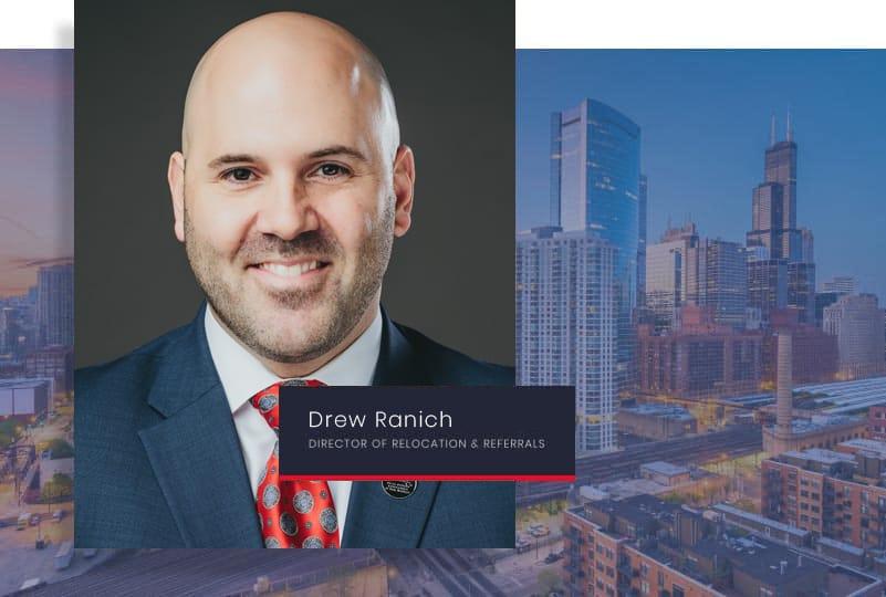 Headshot of Drew Ranich with city skyline background.