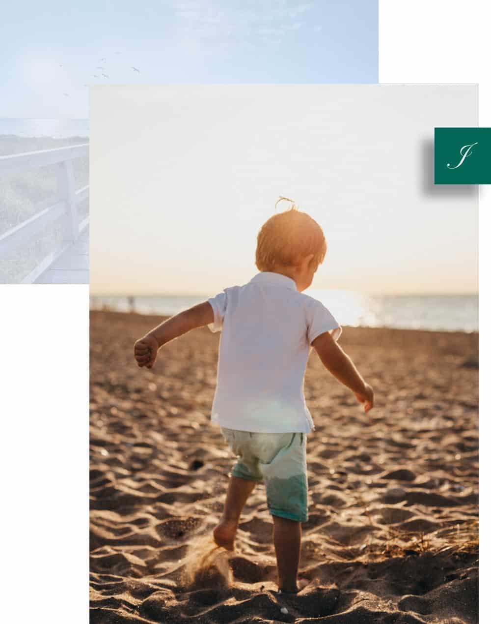 baby walking on sandy beach in the sunshine