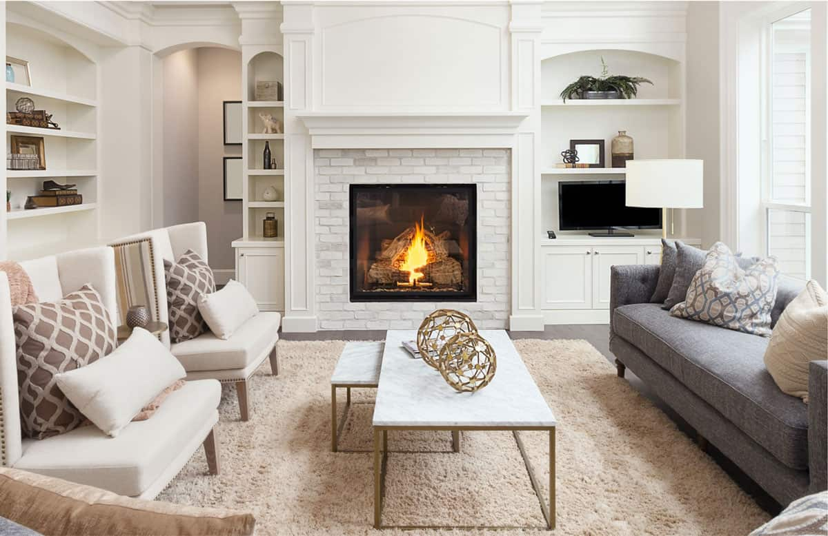 modern living room with white furniture and fireplace